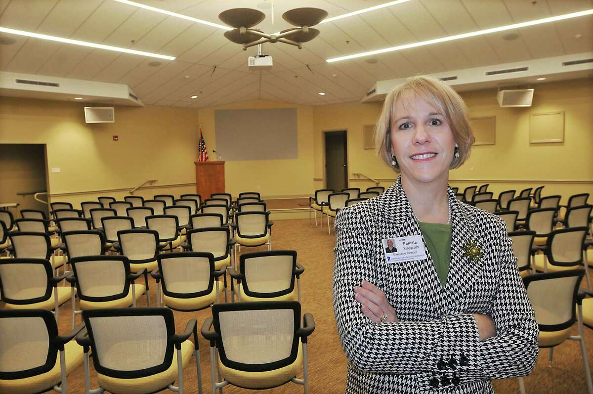 Pamela Klapproth, the new executive director at Covenant Village of Cromwell, is photographed in the new event center. The handicap-accessible room has a seating capacity of 204, features a 100-inch projection HGTV with Blue-Ray and is equipped with hearing-impaired induction loop systems.