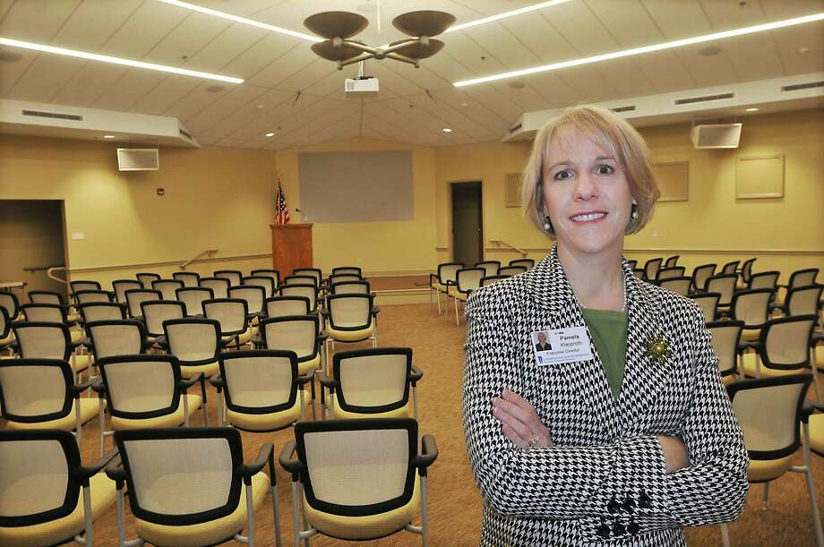 Pamela Klapproth, the new executive director at Covenant Village of Cromwell, is photographed in the new event center. The handicap-accessible room has a seating capacity of 204, features a 100-inch projection HGTV with Blue-Ray and is equipped with hearing-impaired induction loop systems. Photo: Catherine Avalone — The Middletown Press  / TheMiddletownPress