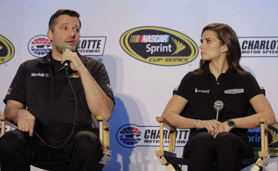Driver Tony Stewart, left, speaks to the media as Danica Patrick listens during the NASCAR Charlotte Motor Speedway media tour on Tuesday in Charlotte, N.C. Photo: Chuck Burton — The Associated Press  / AP