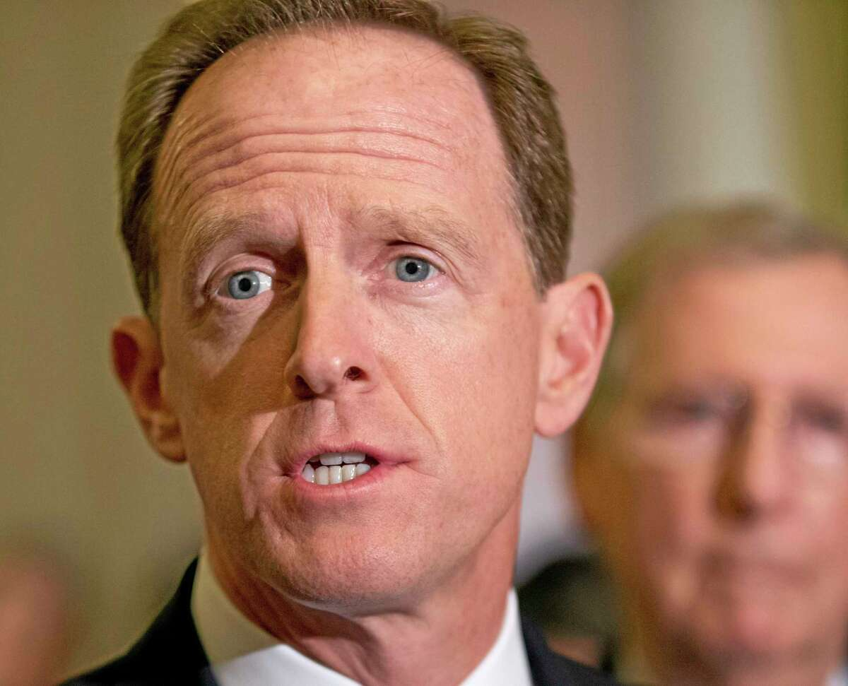 FILE - In this July 30, 2013 file photo, Sen. Pat Toomey, R-Pa. speaks with reporters on Capitol Hill in Washington. Flood insurance rate increases for hundreds of thousands of people would be put off under a bill thatís steaming toward passage in the Senate, powered by coastal lawmakers telling horror stories of constituents at risk of losing their homes with the implementation of an overhaul of the federal flood insurance program passed less than two years ago. The Senate measure to delay some of the changes is likely to pass after votes on a host of amendments, including a plan by Toomey to phase in rate increases more slowly. It was unclear whether the measure will pass on Wednesday or Thursday. (AP Photo/J. Scott Applewhite, File)
