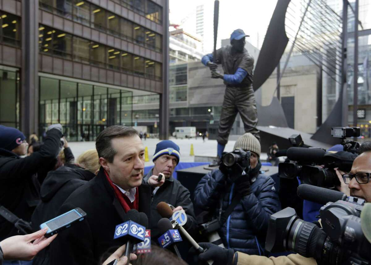 Chicago Cubs chairman Tom Ricketts speaks to the media next to the statue of Hall of Famer Ernie Banks in Daley Plaza as fans get their first chance to pay their respects on Wednesday in Chicago.