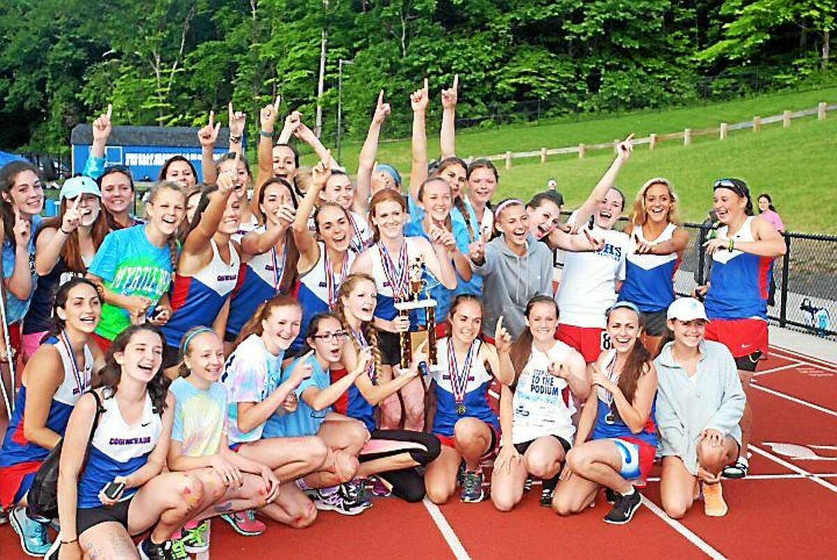 The Coginchaug girls outdoor track and field team celebrates after winning the Shoreline Conference championship on Wednesday in Durham. The Blue Devils earned 144 points, while runner-up Old Saybrook had 125 points.