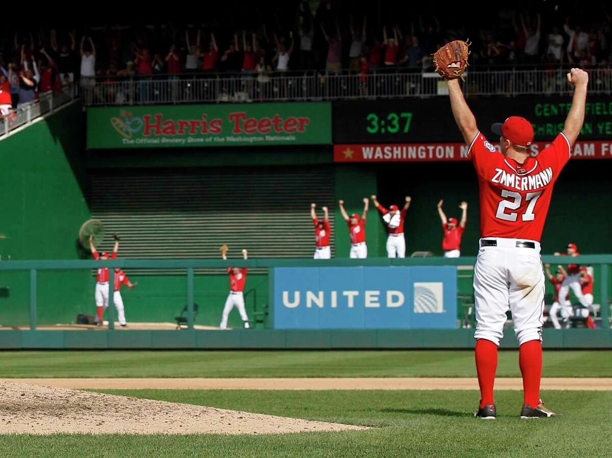 Washington Nationals starting pitcher Jordan Zimmermann (27) celebrates, as do players in the bullpen, after the last out in Zimmermann's no-hitter against the Marlins on Sunday in Washington.