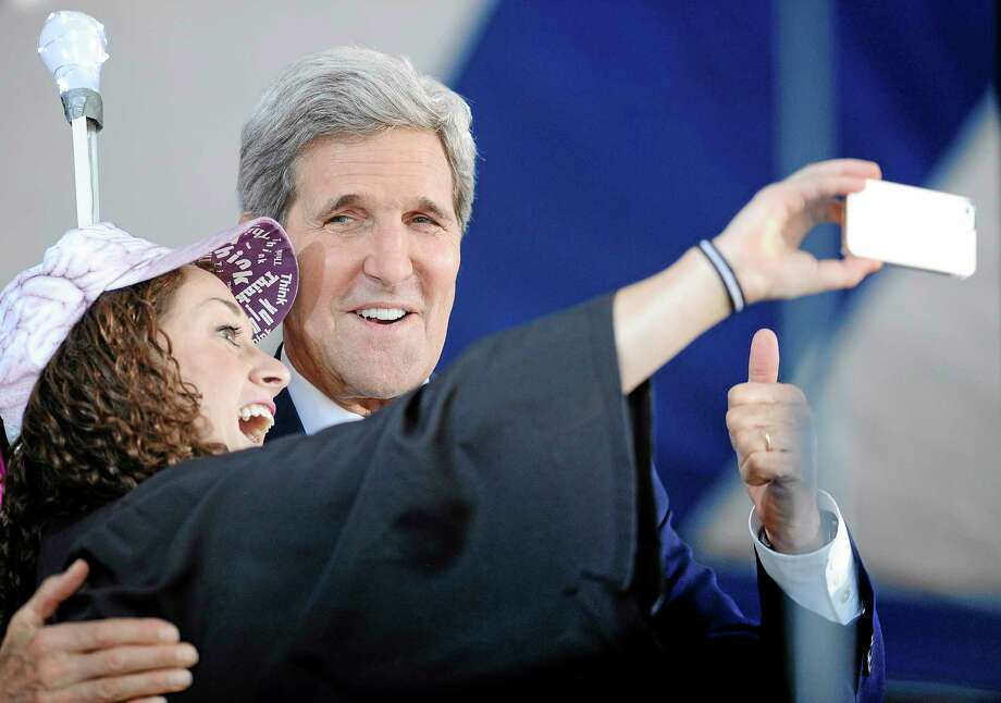 Secretary of State John Kerry, right poses for a selfie with Yale student Ariel Kirshenbaum during Class Day at Yale University, Sunday, May 18, 2014, in New Haven, Conn. (AP Photo/Jessica Hill) Photo: AP / FR125654 AP