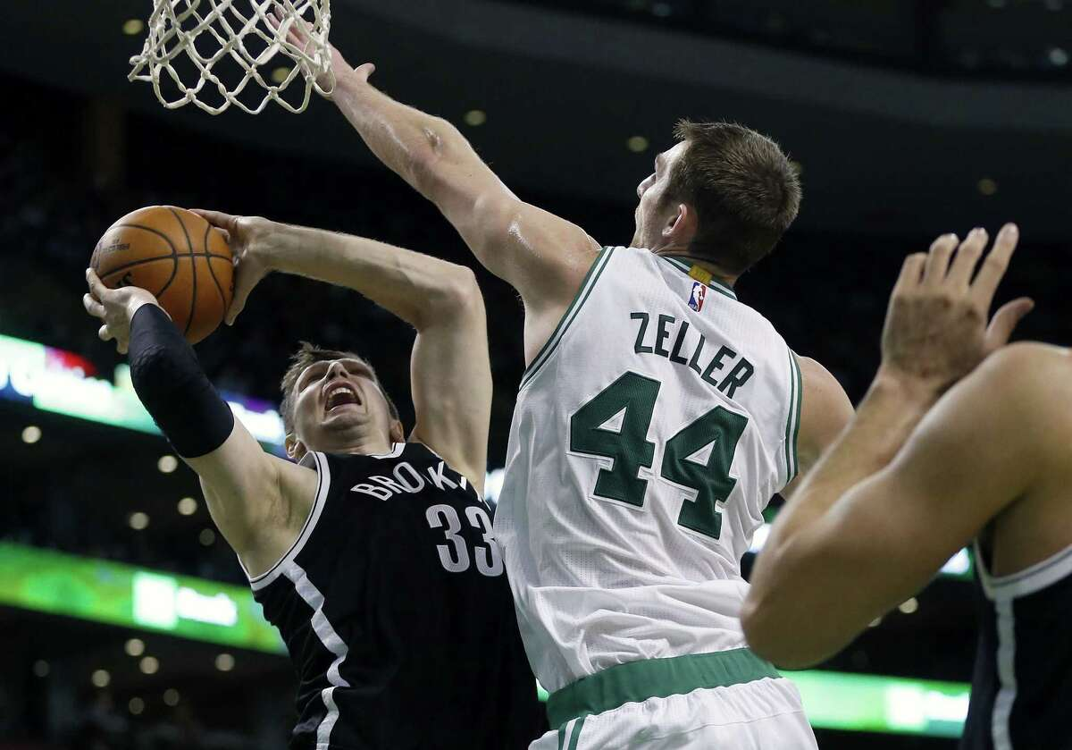 The Celtics' Tyler Zeller blocks a shot by the Brooklyn Nets' Mirza Teletovic during a Dec. 26 game in Boston.