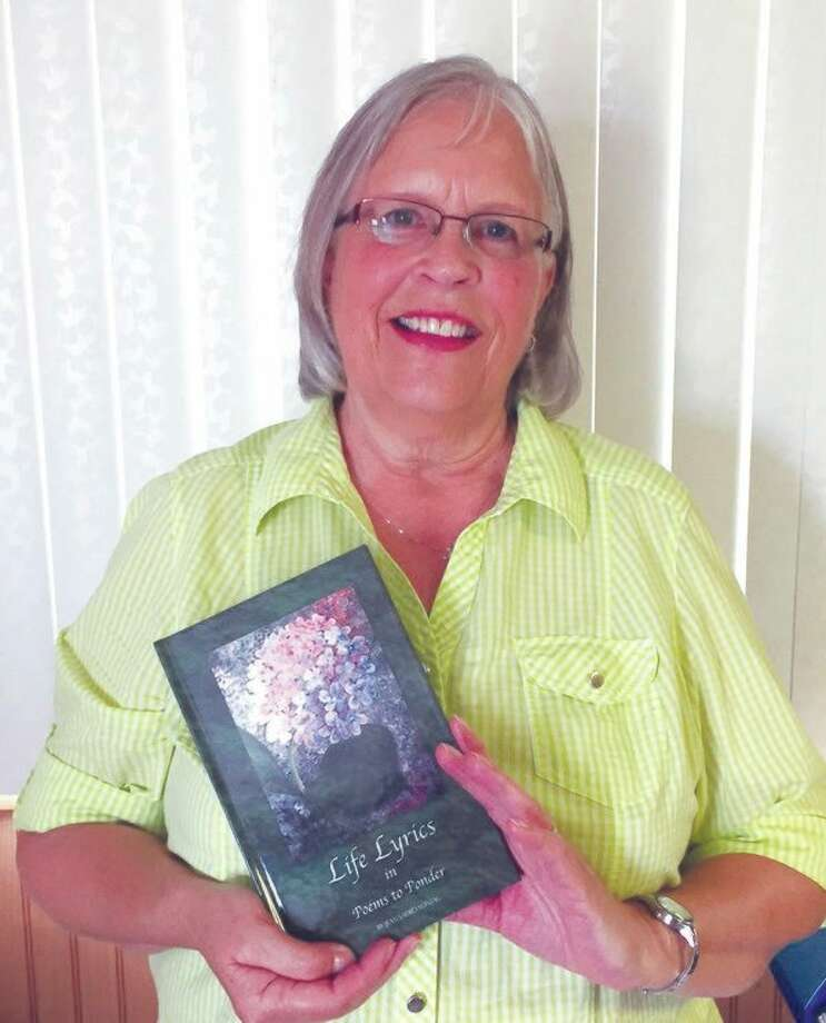 Deckerville author, Jean Sadro Sontag, poses with her new inspirational poetry book, Life Lyrics in Poems to Ponder. (Submitted Photo)