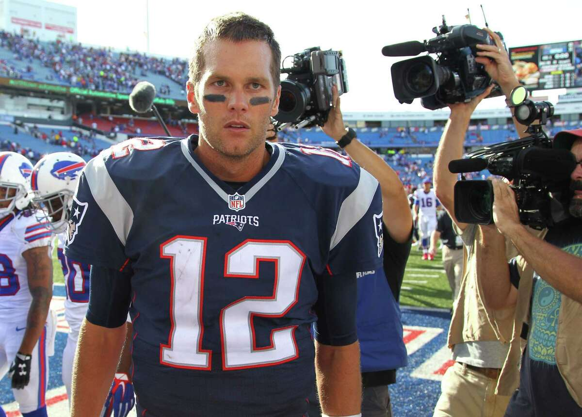 New England Patriots quarterback Tom Brady (12) leaves the field after an NFL football game against the Buffalo Bills Sunday, Sept. 20, 2015, in Orchard Park, N.Y. The Patriots won the game 40-32. (AP Photo/Bill Wippert)
