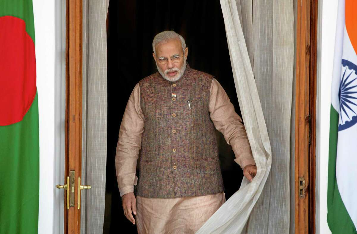 Indian Prime Minister Narendra Modi, comes out to receive the speaker of Bangladesh's Parliament Shirin Sharmin Chaudhury, in New Delhi, India, Tuesday, May 27, 2014. Modi met with the leaders of rival Pakistan and other neighboring nations on Tuesday, a day after being sworn in. (AP Photo /Manish Swarup)