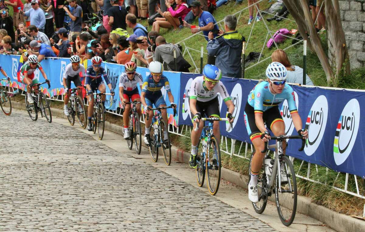 Cyclists navigate the cobblestones on Libby Hill during the Women's Elite road circuit cycling race at the UCI Road World Championships in Richmond, Va. on Sept. 26, 2015.
