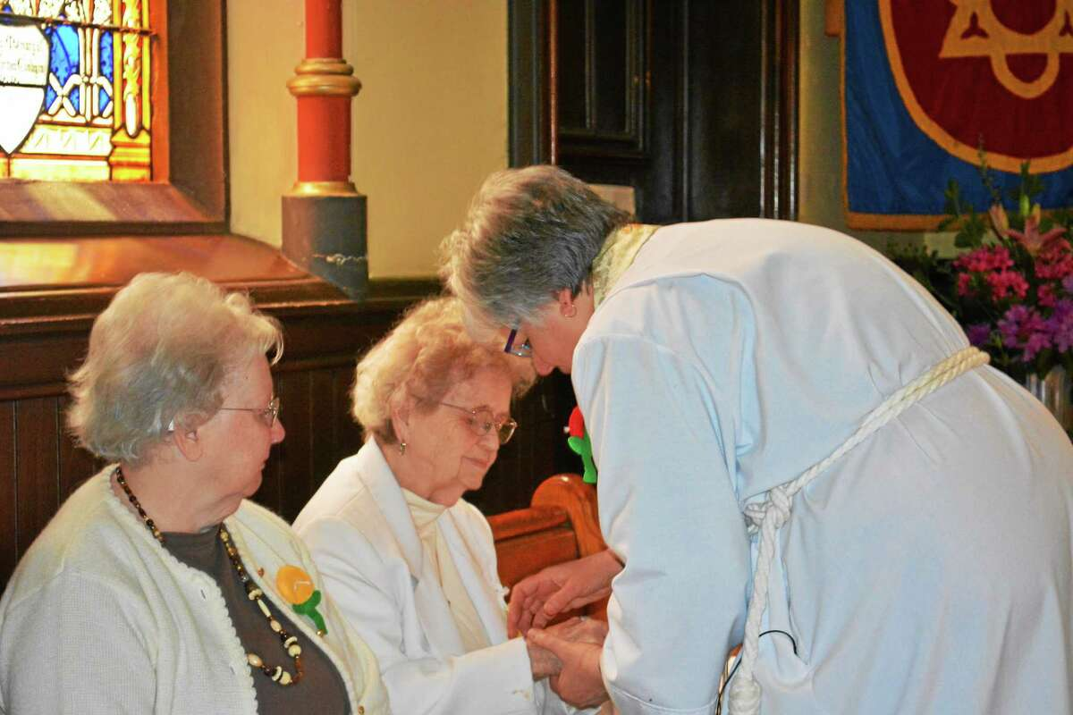 Kaitlyn Schroyer - The Middletown Press As part of the Church of Holy Trinity's Shut-In service, the clergy provided personal blessings to those attending the service Thursday.