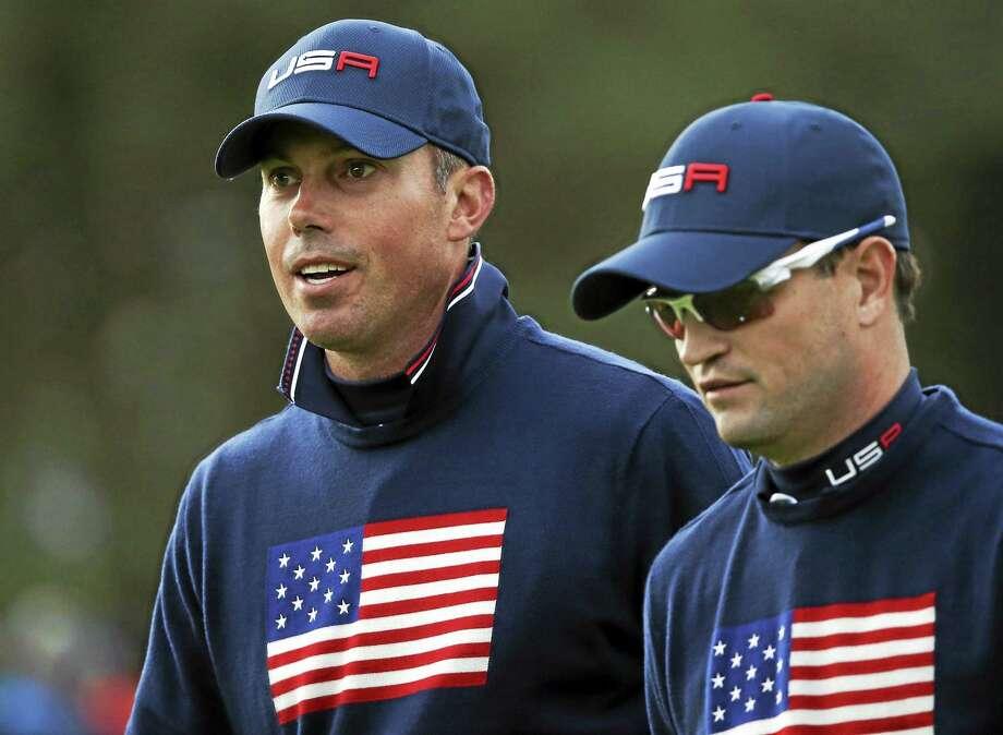 Matt Kuchar, left, and Zach Johnson of the U.S. walk to the 16th tee box on Saturday. Photo: Peter Morrison — The Associated Press  / AP
