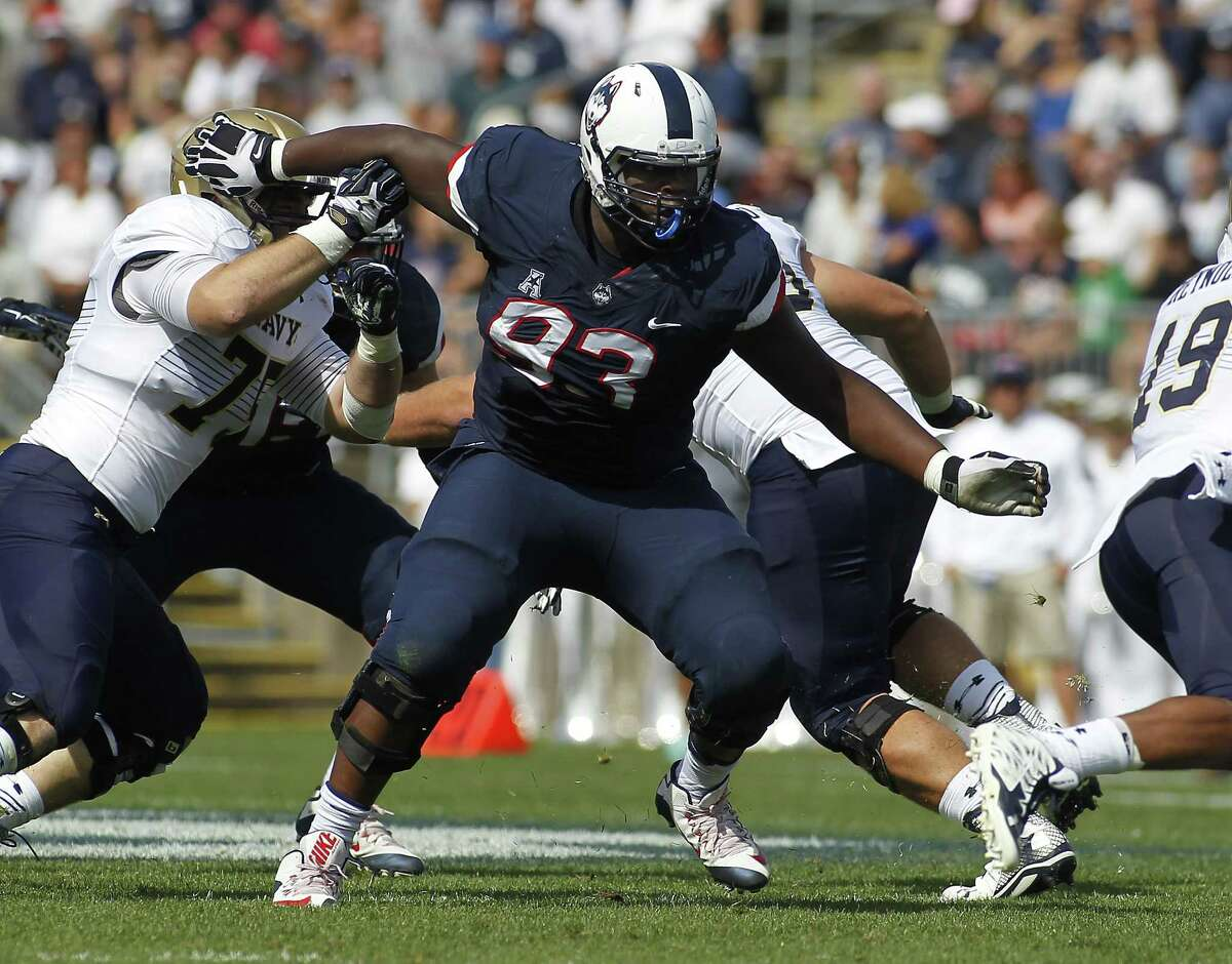 Connecticut defensive lineman Foley Fatukasi (93) during the second quarter of an NCAA college football game against Navy, Saturday, Sept. 26, 2015, in East Hartford, Conn. Three years after Superstorm Sandy forced his family from their home, Connecticut's Fatukasi has settled into a central part of the Huskies defensive line.
