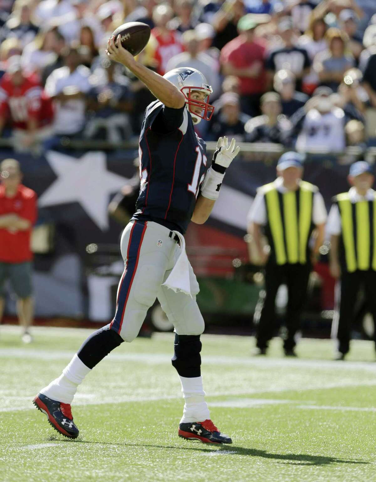 New England Patriots quarterback Tom Brady throws a touchdown pass to wide receiver Danny Amendola, the 400th of Brady's NFL career, in the first half of an NFL football game against the Jacksonville Jaguars, on Sept. 27, 2015 in Foxborough, Mass.