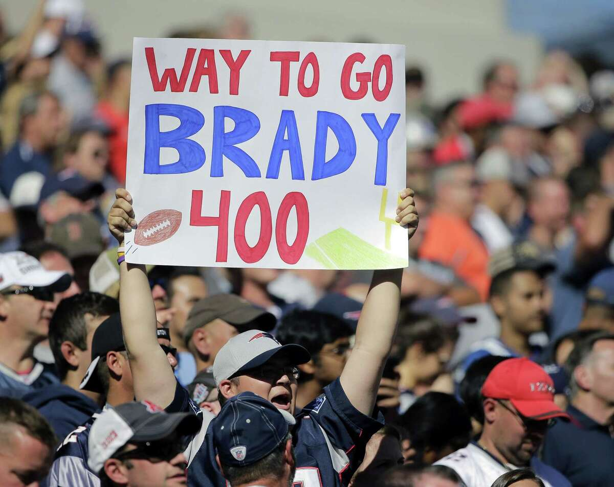 A fan celebrates the 400th career touchdown pass by New England Patriots quarterback Tom Brady in the first half of an NFL football game against the Jacksonville Jaguars on Sept. 27, 2015, in Foxborough, Mass.