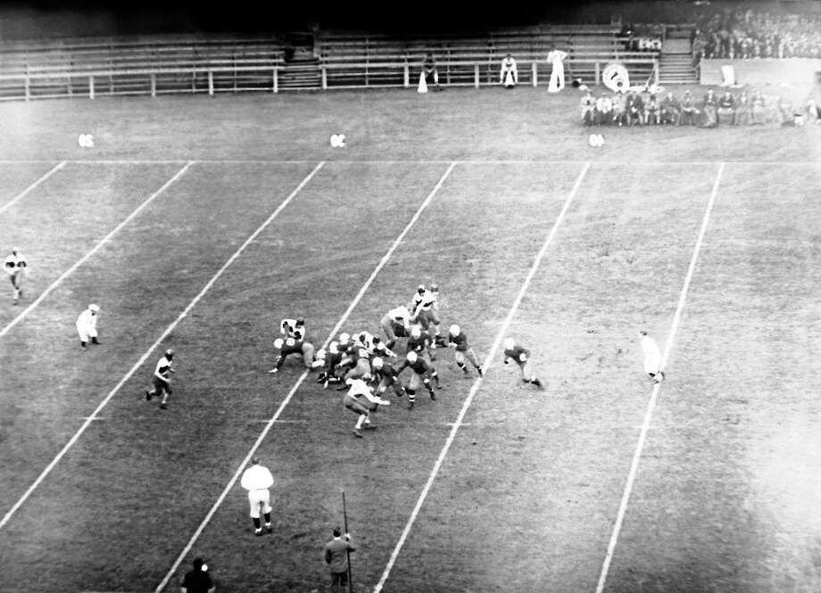 Albie Booth gains 15 yards for Yale during the Bulldogs' 21-0 win over Brown on Oct. 18, 1930 in New Haven. Photo: The Associated Press File Photo