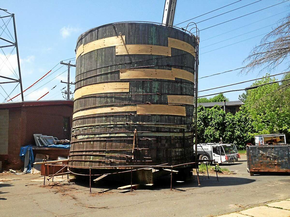 Now that removal of the water tower in East Hampton is complete, the steel and weathered wood will be recycled. Some residents have asked officials for a piece of the wooden boards as a memento.