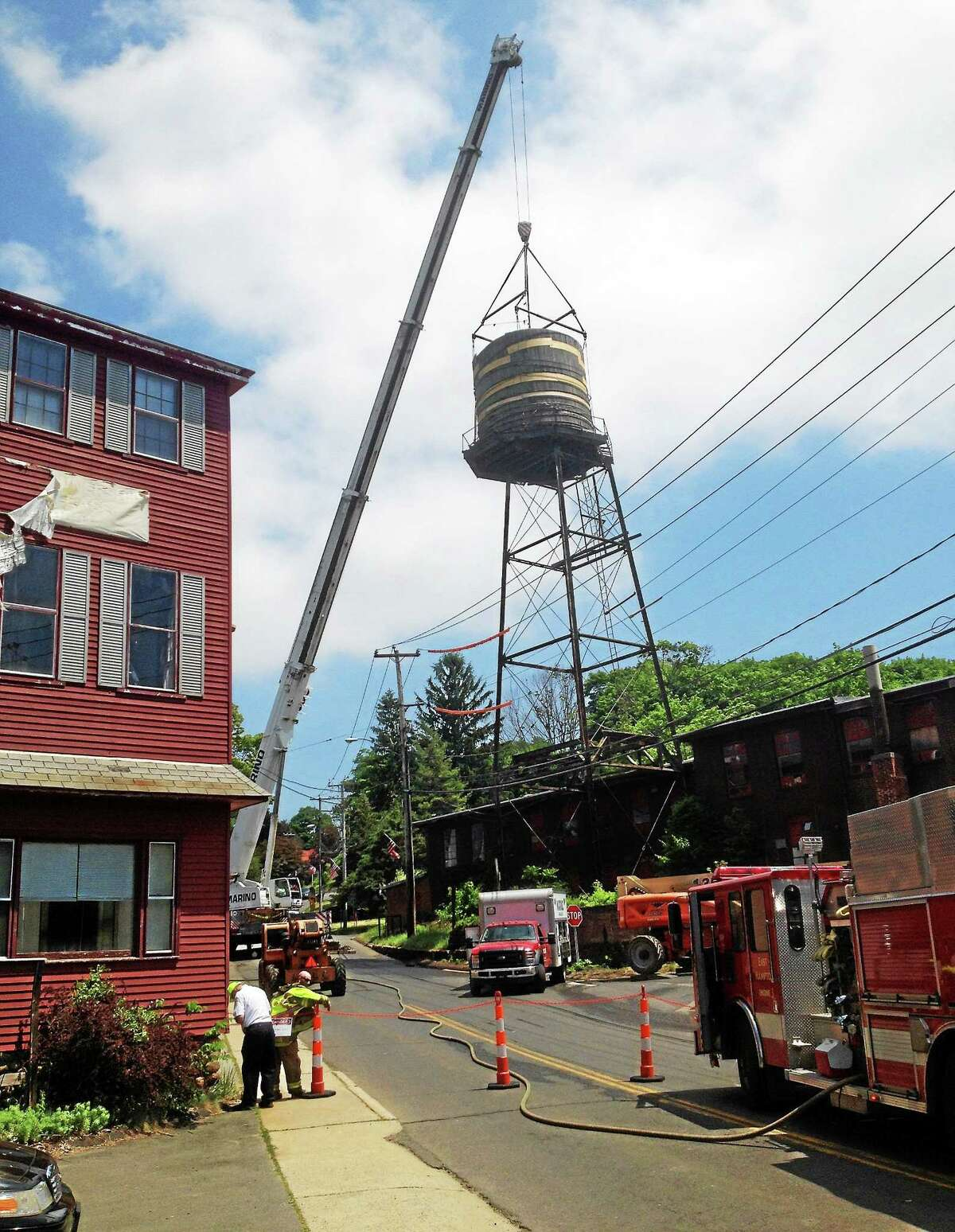 East Hampton's massive and aging water tower was taken down Wednesday, a massive project that went off without a hitch in the Village Center.