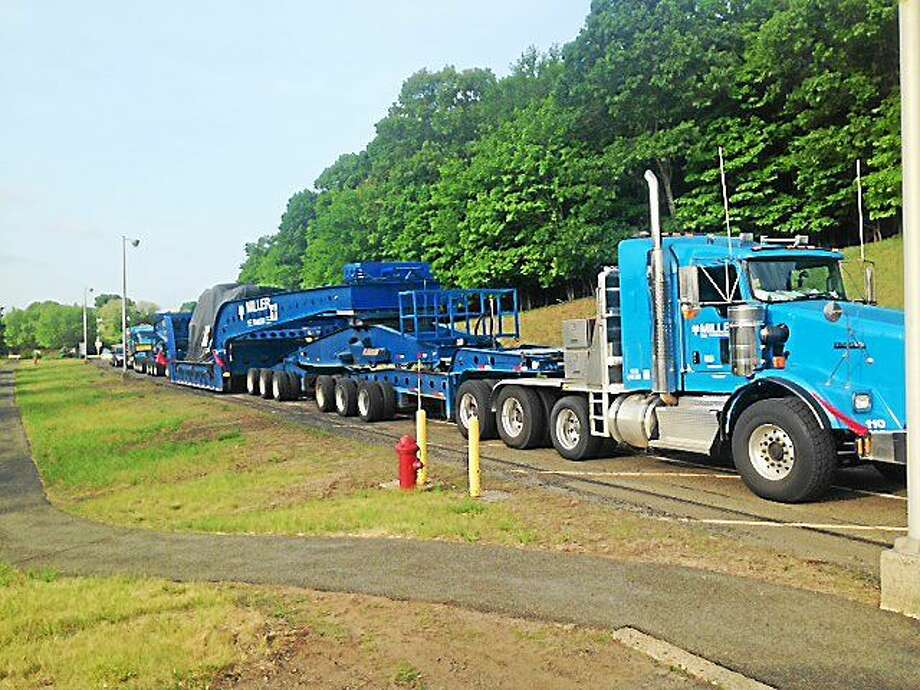 A 200-ton welding machine, transported on a truck as long as the distance from a ballpark's home plate to center field, arrived late Tuesday night at Pratt & Whitney in Middletown. Photo: Courtesy Pratt & Whitney