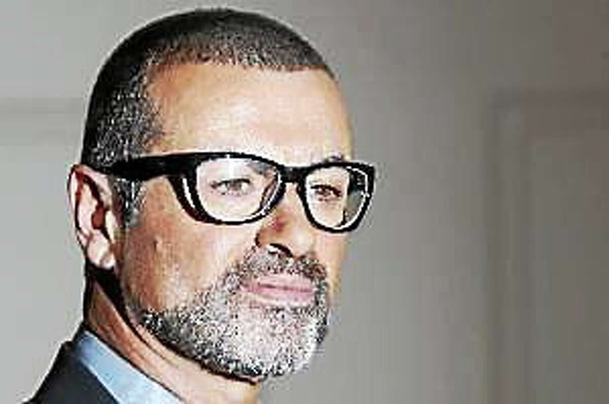 In this May 11, 2011, file photo British singer George Michael poses for the cameras at an event to announce his European Orchestral tour in London.