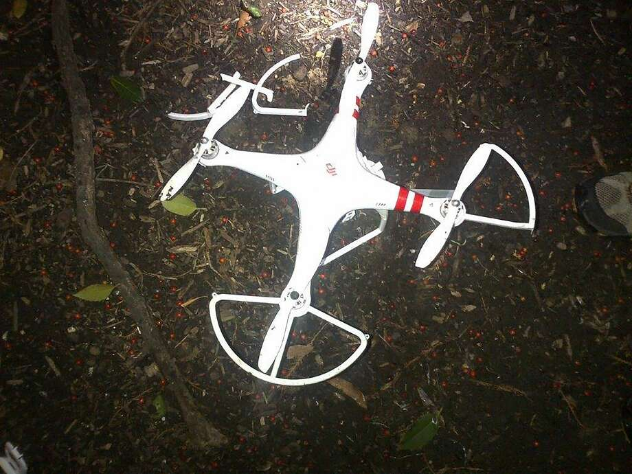 This handout photo provided by the US Secret Service shows the drone that crashed onto the White House grounds in Washington, Monday, Jan. 26, 2015. A small drone flying low to the ground crashed onto the White House grounds before dawn Monday, triggering a major emergency response and raising fresh questions about security at the presidential mansion. A man later came forward to say he was responsible and didn't mean to fly it over the complex. The man contacted the Secret Service after reports of the crash spread in the media, a U.S. official said. The man told the agency that he had been flying the drone recreationally. The man is a Washington resident and is cooperating with investigators. (AP Photo/US Secret Service) Photo: AP / US Secret Service