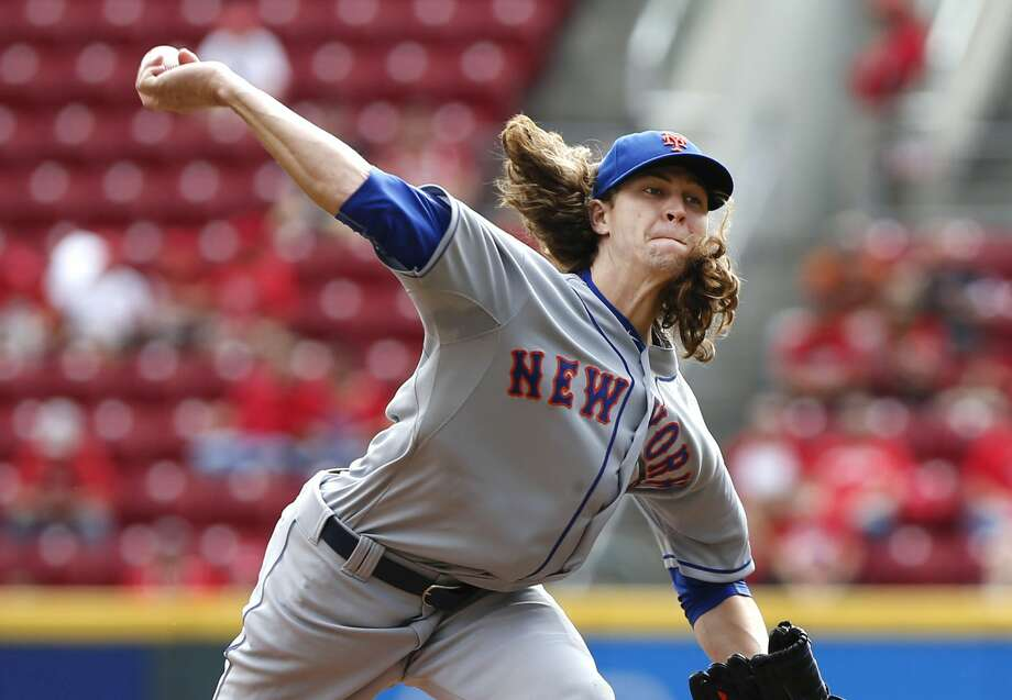 Jacob deGrom throws a pitch in the first inning of Sunday's game against the Reds. Photo: Aaron Doster — The Associated Press  / AP
