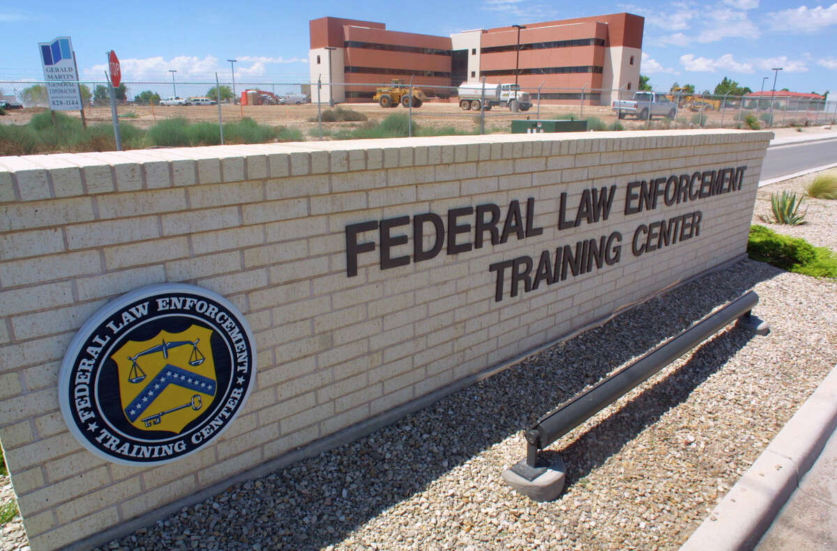 FILE - In this Aug. 1, 2002 file photo, a sign outside the Federal Law Enforcement Training Center in Artesia, N.M. The Homeland Security Department has privately acknowledged that a remarkable number of young families caught crossing the border illegally earlier this year subsequently failed to meet with federal immigration agents, as they were instructed. At the meeting, the ICE official acknowledged the no-show figures while explaining the administrationís decision in June to open a temporary detention center for families in Artesia, New Mexico. A second immigration jail in Texas was later converted for families and can house about 530 people. A third such detention center will open in Texas later this year. Before the new facility in Artesia, the government had room for fewer than 100 people at its only family detention center in Pennsylvania.