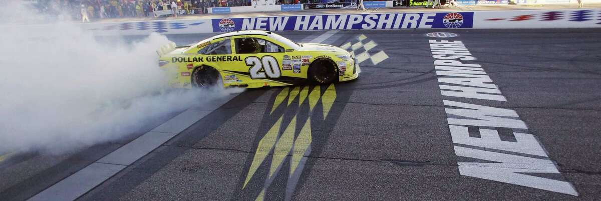 Matt Kenseth celebrates at the finish line after winning the NASCAR Sprint Cup series race at New Hampshire Motor Speedway on Sunday.