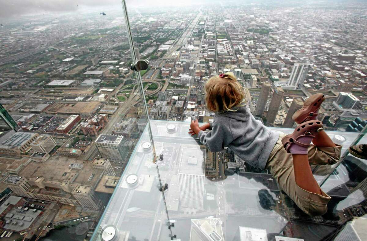 FILE - This June 24, 2009 file photo shows Anna Kane, 5, looking down from the