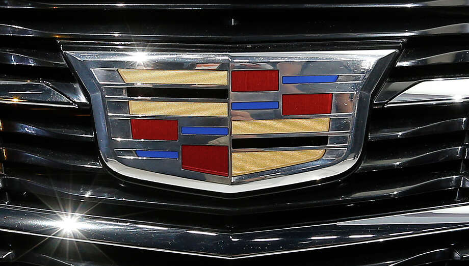 This Jan. 14 photo shows the Cadillac logo on the 2015 ATS coupe during its debut at media previews during the North American International Auto Show in Detroit. Photo: Paul Sancya — The Associated Press  / AP
