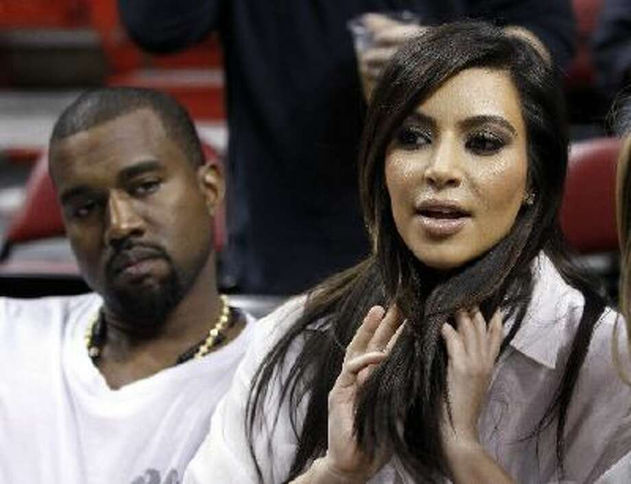 Kim Kardashian and Kanye West at a game between the Miami Heat and the New York Knicks on Dec, 6, 2012 in Miami.