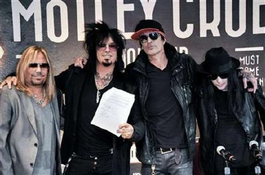 From left, Vince Neil, Nikki Sixx, Tommy Lee, and Mick Mars attend the Motley Crue Press Conference, Tuesday, Jan. 28, 2014, in Los Angeles.