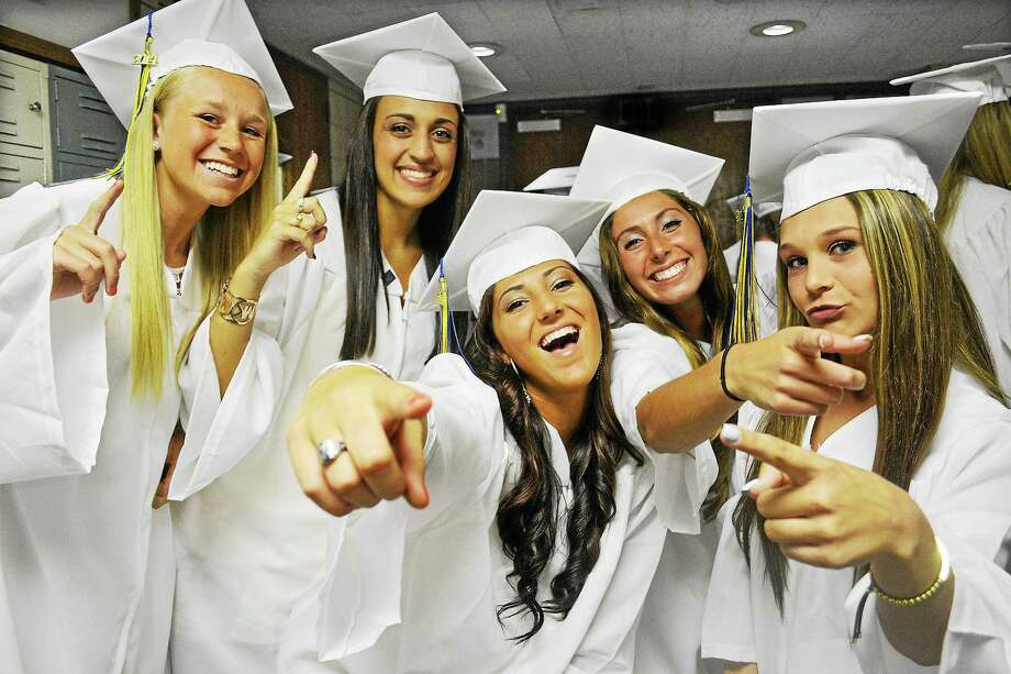 Members of Mercy's graduating class of 2014 Danielle Veronneau, Danielle Ternullo, Janella Spada, Juliana Tavarozzi and Emma Thomas celebrate shortly before processing into the auditorium Thursday evening. Photo: Catherine Avalone — The Middletown Press