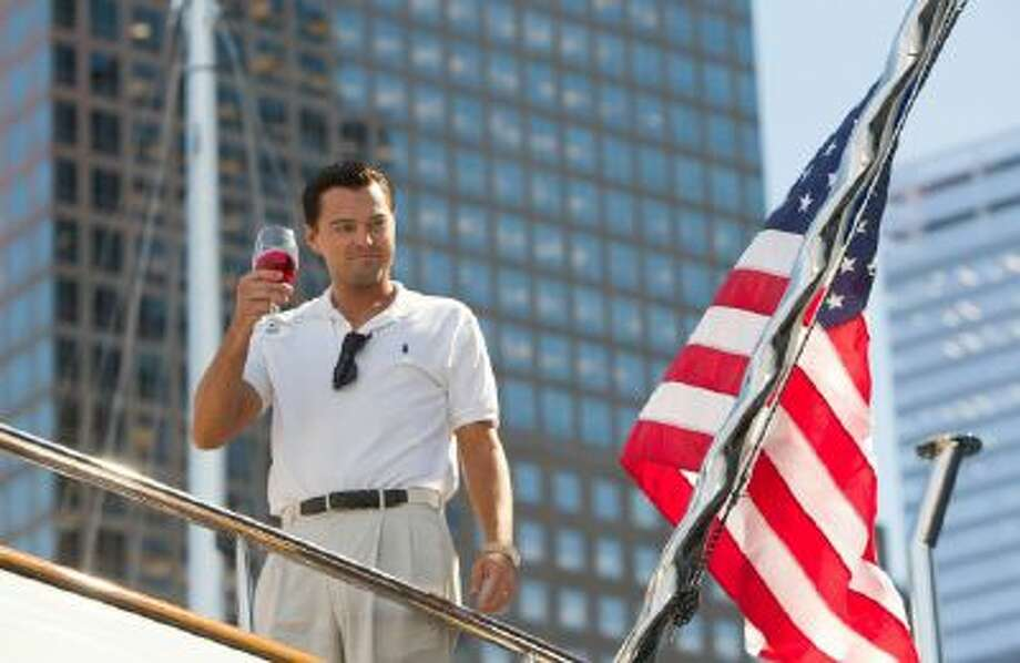 """This film image released by Paramount Pictures shows Leonardo DiCaprio as Jordan Belfort in a scene from """"The Wolf of Wall Street."""""""