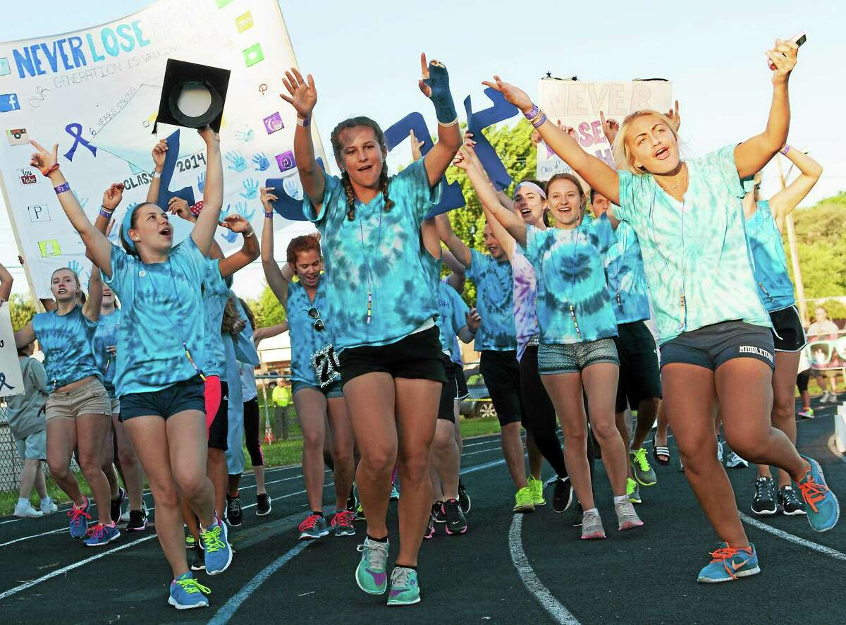 Cancer survivors and their supporters participate in the Greater Middletown Relay for Life at Woodrow Wilson Middle School in this 2014 file photo.