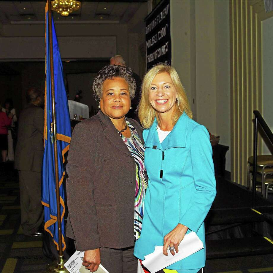 Aetna President Karen S. Lynch spoke at the Middlesex County Chamber of Commerce September breakfast meeting. She is shown, at right, with Faith Jackson, director of the City of Middletown Human Relations Department, left. Photo: De Kine Photo LLC   / Rice Creek Photo