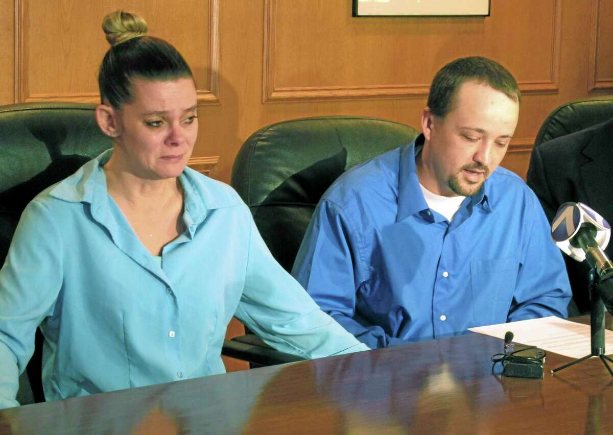 Missie McGuire, left, listens to her husband, Dennis McGuire, at a news conference on Jan. 17, 2014, in Dayton, Ohio, where they announced their planned lawsuit against the state over the unusually slow execution of his father, also named Dennis McGuire.