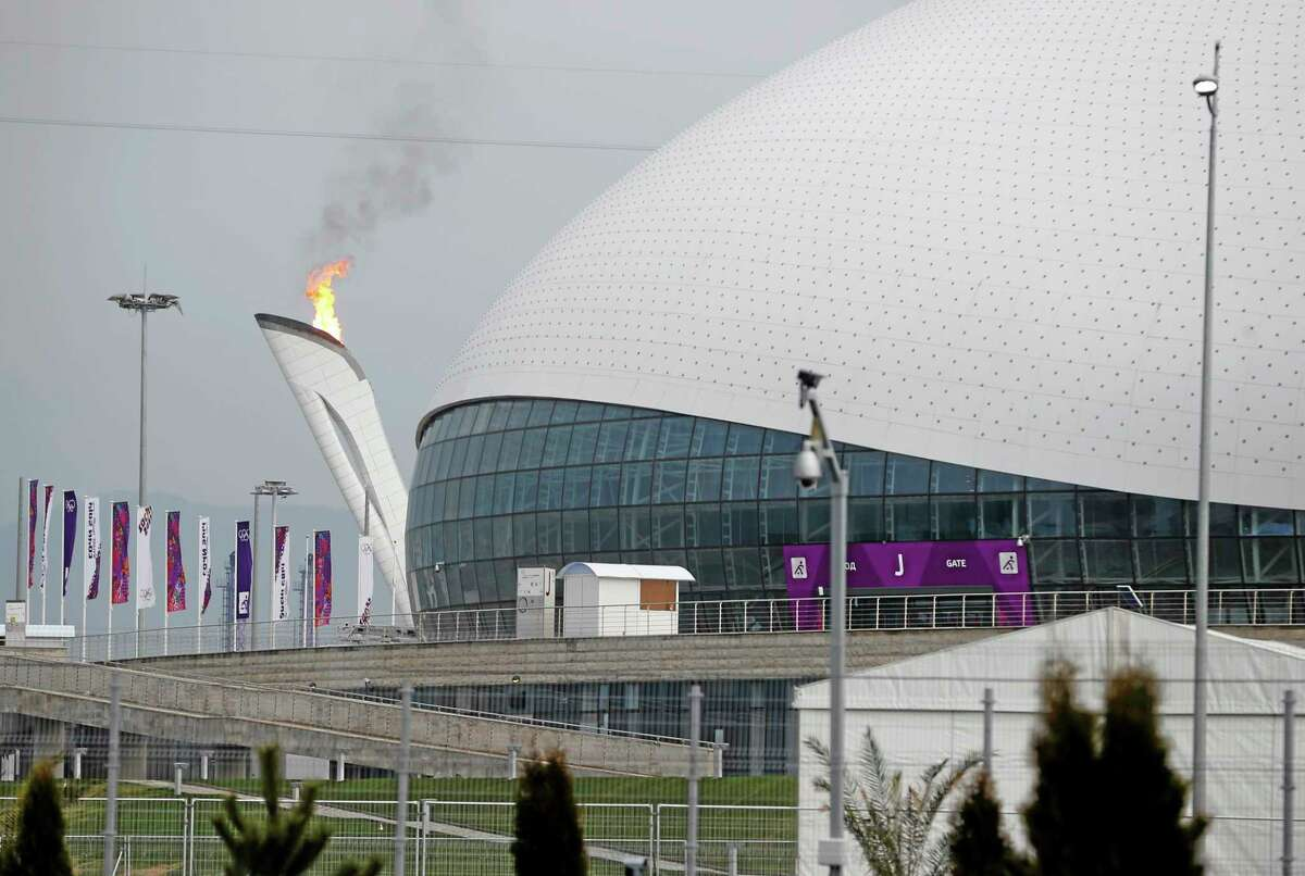 The Olympic flame is lit during a test next to the Bolshoy Ice Dome before the start of the 2014 Winter Olympics, Wednesday, Jan. 29, 2014, in Sochi, Russia. (AP Photo/Pavel Govolkin)