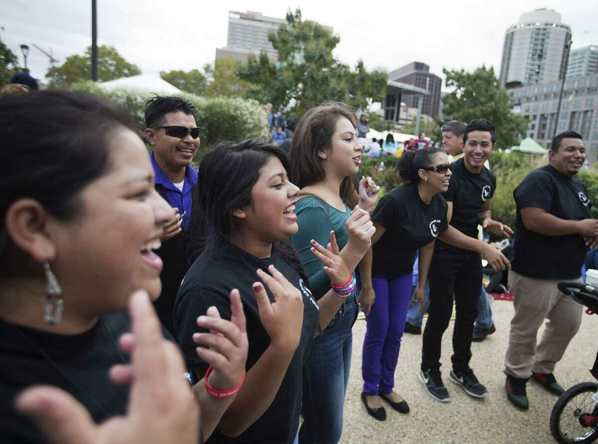 Church members from Frederick, Md., sing and dance along Benjamin Franklin Parkway ahead of Pope Francis' parade and Mass Sunday, Sept. 27, 2015, in Philadelphia.