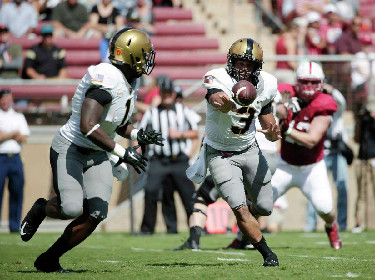 Army quarterback Angel Santiago (3) pitches to running back Raymond Maples during the first half of a Sept. 13 game in Stanford, Calif.