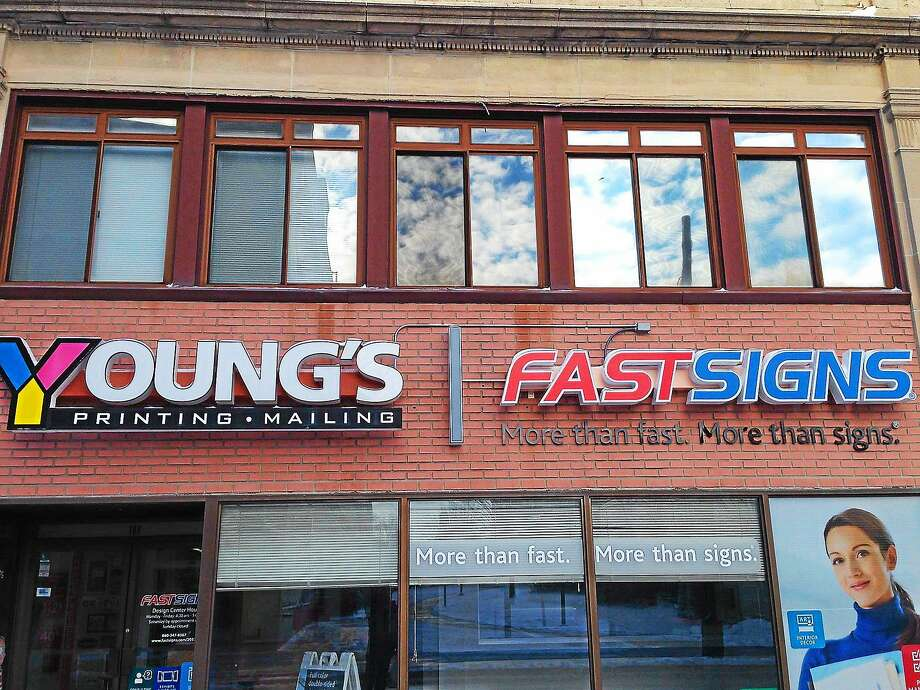 Young's recently was awarded Community Development Block Grant by the City of Middletown to help its expansion to include a FASTSIGNS center, a worldwide franchise that specializes in large-format solutions. The growth of the shop, located at 182 Court St., has added three new jobs for low-income residents, according to the city planner's office. Photo: Courtesy Young's Printing