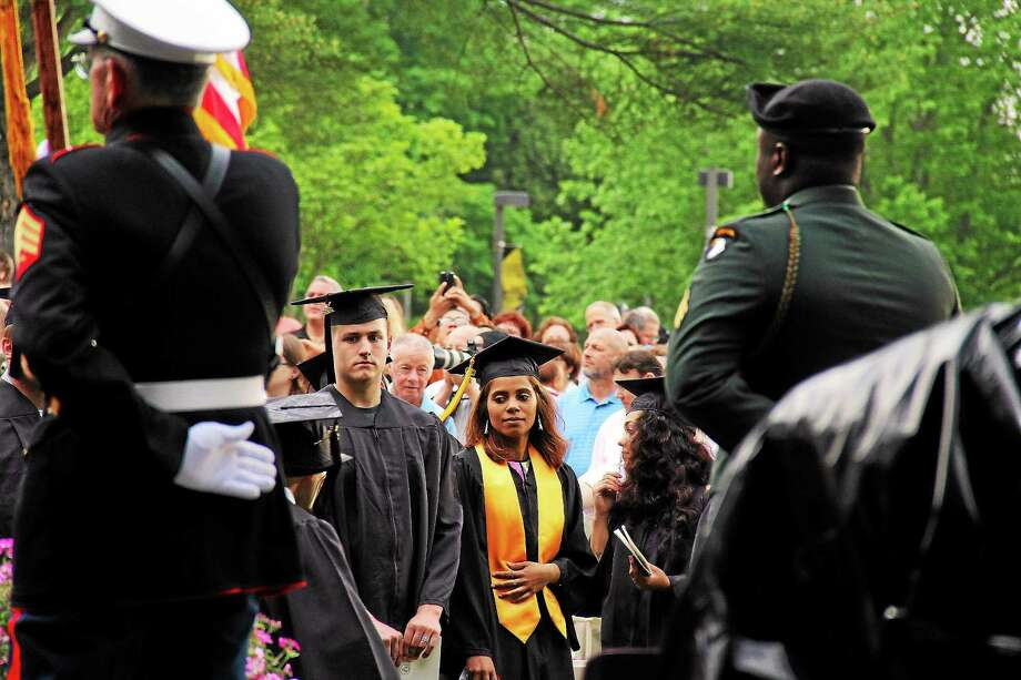 (Kathleen Schassler/Middletown Press) Storm clouds were chased away by sunshine during the graduation ceremony for 404 members of Middlesex Community College's Class of 2015. The school celebrated its 48th annual commencement ceremony this year. Photo: Journal Register Co. / Kathleen Schassler All Rights