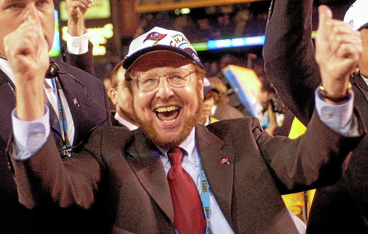 In this Jan. 26, 2003 file photo, Tampa Bay Buccaneers owner Malcolm Glazer celebrates the Bucs' 48-21 victory over the Oakland Raiders in Super Bowl XXXVII in San Diego. Glazer, the self-made billionaire who owned the Bucs and English soccer's Manchester United, has died at 85.