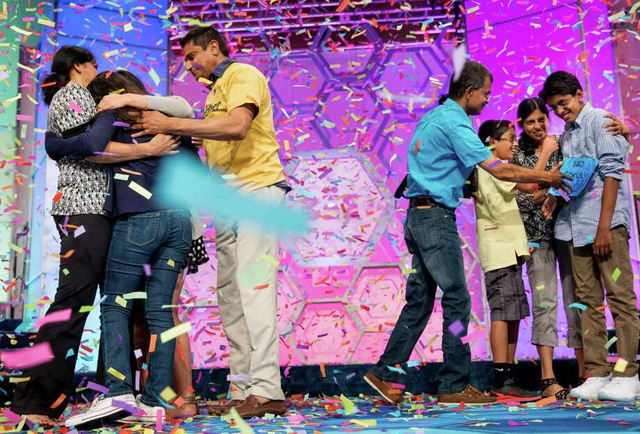 Vanya Shivashankar, second from left, 13, of Olathe, Kan., and Gokul Venkatachalam, right, 14, of St. Louis, are greeted onstage by their families as co-champions after winning the finals of the Scripps National Spelling Bee, Thursday, May 28, 2015, in Oxon Hill, Md. Photo: (AP Photo/Andrew Harnik) / AP