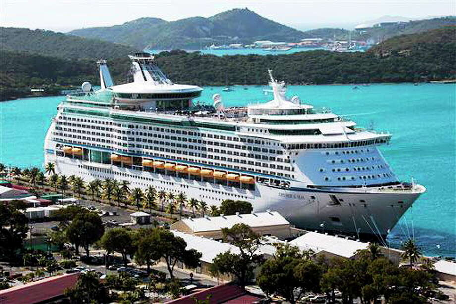 The Royal Caribbean International's Explorer of the Seas is docked at Charlotte Amalie Harbor in St. Thomas, U. S. Virgin Islands, Sunday, Jan. 26, 2014. U.S. health officials have boarded the cruise liner to investigate an illness outbreak that has stricken at least 300 people with gastrointestinal symptoms including vomiting and diarrhea. (AP Photo/Thomas Layer) Photo: AP / AP
