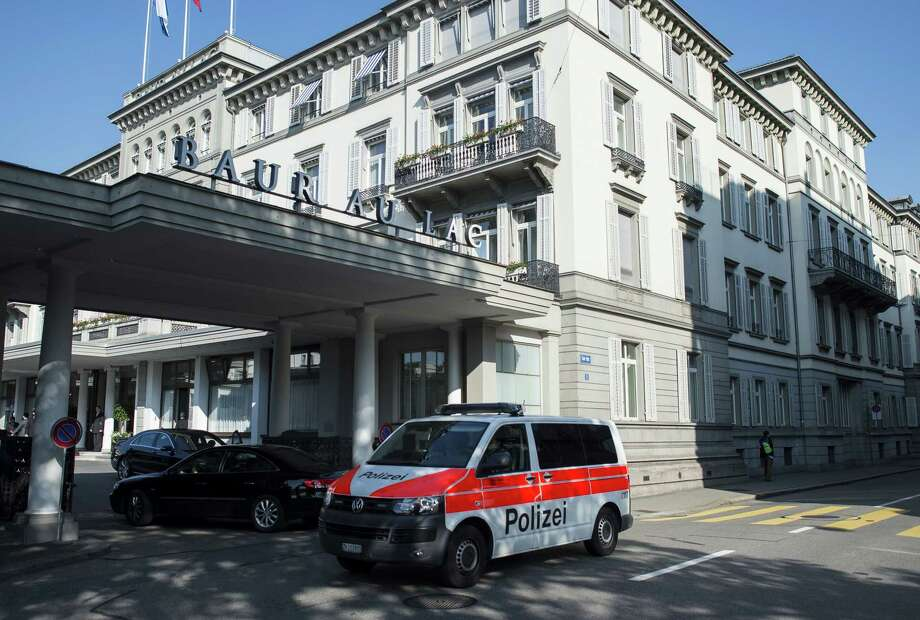 A police vehicle is parked outside of the five-star hotel Baur au Lac in Zurich, Switzerland, on Wednesday morning. Photo: Ennio Leanza — The Associated Press  / KEYSTONE