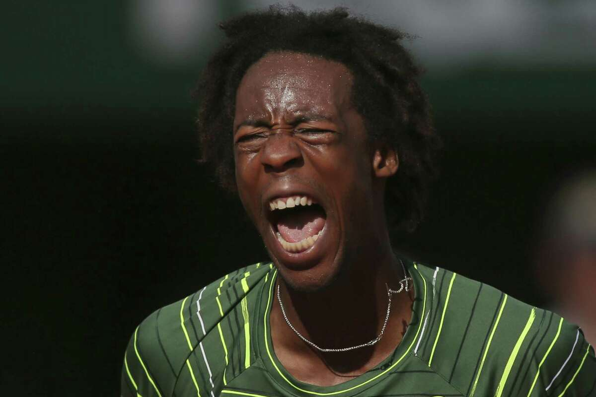 France's Gael Monfils screams as he scores a point in a second-round match at the French Open against Diego Schwarztman in Paris on Wednesday.