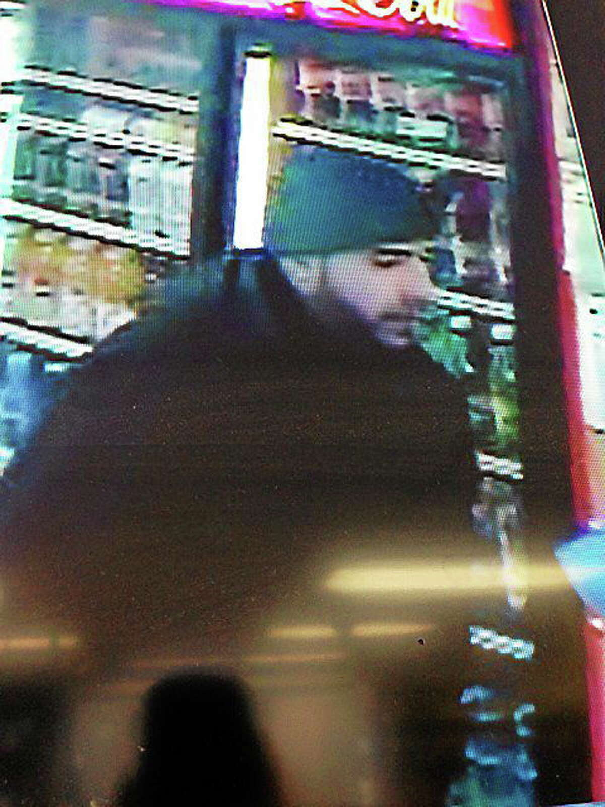 Video surveillance of a suspected counterfeiter. Provided by Cromwell Police