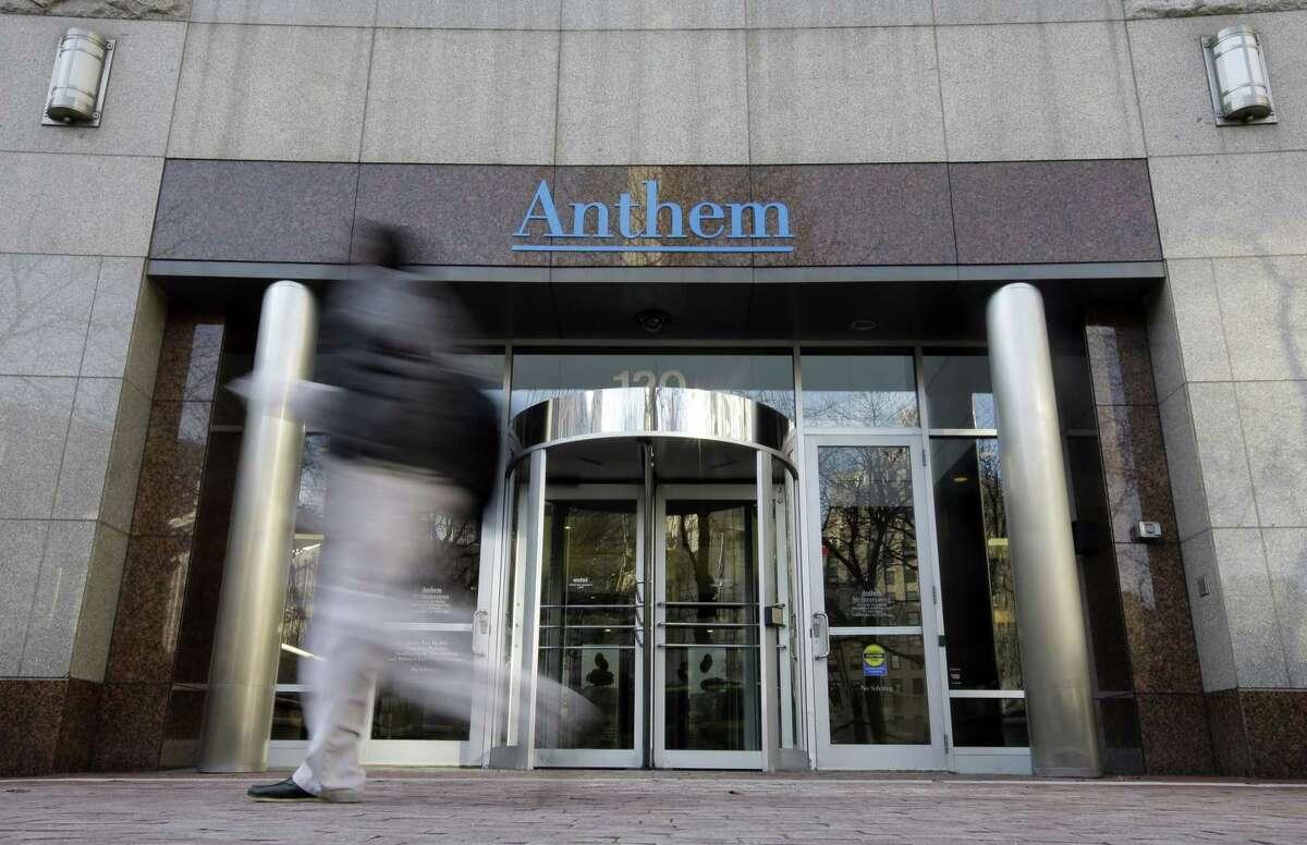 AP Photo/Darron Cummings, File In this Dec. 3, 2014 photo, a pedestrian walks past the corporate headquarters of health insurer Anthem, in Indianapolis.