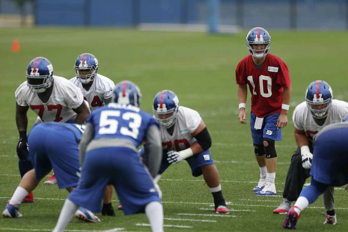 New York Giants quarterback Eli Manning (10) runs a play during an organized team activity on Wednesday in East Rutherford, N.J.
