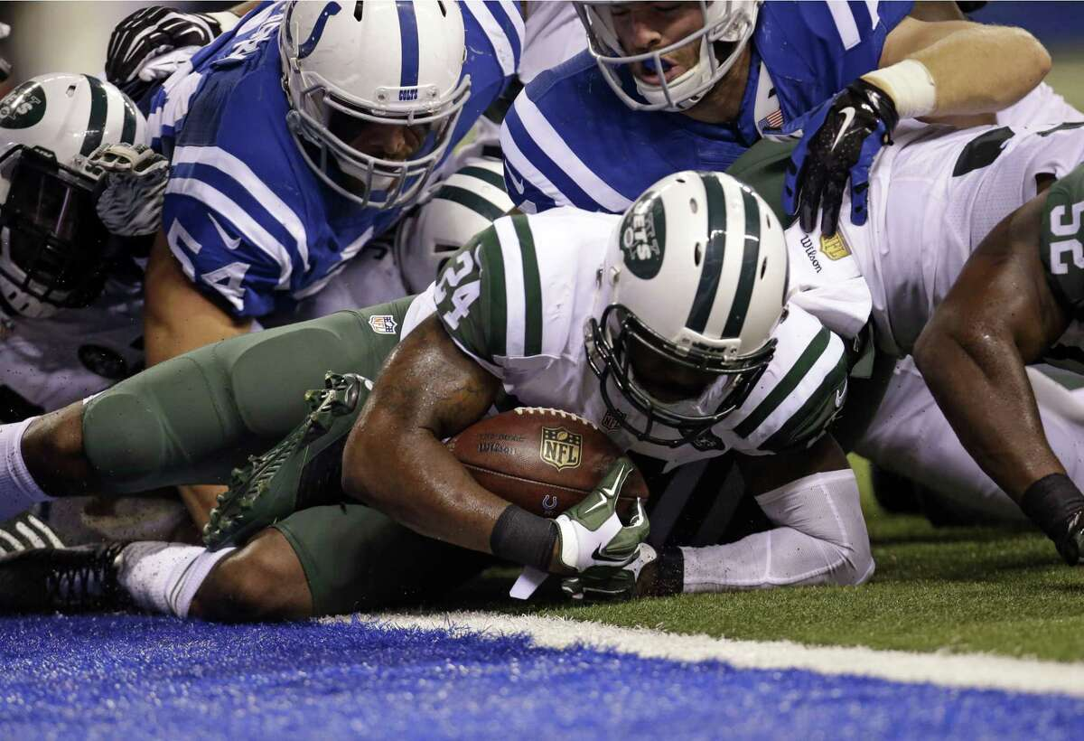 New York Jets cornerback Darrelle Revis (24) recovers a fumble by Indianapolis Colts running back Frank Gore (23) during the second half Monday. The Jets are 2-0 and a large reason for the strong start is their sudden penchant for causing turnovers.